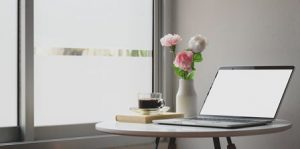 online counseling Nashville - laptop ontable with coffee and flowers